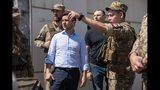 Ukrainian President Volodymyr Zelenskiy, center, listens to a serviceman as he visits the war-hit Luhansk region, eastern Ukraine, Monday, May 27, 2019. (Ukrainian Presidential Press Office via AP)