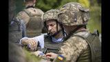 Ukrainian President Volodymyr Zelenskiy talks with servicemen as he visits the war-hit Luhansk region, eastern Ukraine, Monday, May 27, 2019. (Ukrainian Presidential Press Office via AP)