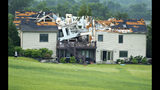 A destroyed home sits in a neighborhood after it was hit by a tornado on Tuesday, May 28, 2019, south of Lawrence, Kan., near US-59 highway and N. 1000 Road. The past couple of weeks have seen unusually high tornado activity in the U.S., with no immediate end to the pattern in sight. (Chris Neal/The Topeka Capital-Journal via AP)