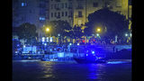 A rescue boat searches for victims late Wednesday, May 29, 2019, after a tourist boat crashed with a river cruise boat, in River Danube in Budapest. The boat capsized and sunk in the river Wednesday evening, with dozens of people on board, including passengers and crew, Hungarian media reported.(Peter Lakatos/MTI via AP)