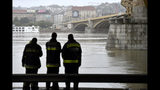 Firemen stand at Margit Bridge, where the wreck of a sightseeing boat was found on the Danube River in downtown Budapest, Hungary, Thursday, May 30, 2019, after a sightseeing boat sank. A massive search was underway on the river for 21 people missing after the sightseeing boat with 33 South Korean tourists sank after colliding with another vessel during an evening downpour. (Zoltan Mathe/MTI via AP)