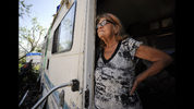 In this May 1, 2019, photo, Janelle Crosby stands in a donated recreational vehicle where she has lived with her husband since Hurricane Michael in Springfield, Fla. Crosby fears the beginning of hurricane season on June 1, and she said she isn't sure what would happen if another storm struck the hard-hit Florida Panhandle. (AP Photo/Jay Reeves)