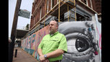 """In this May 9, 2019, photo, business owner Keith Bassett discusses his effort to renovate a building in the Strand, the Galveston, Texas, historic downtown district. The restoration of the historic building is part of an ongoing rebirth of downtown Galveston following the devastation the city suffered when Hurricane Ike made landfall in 2008. """"The city is definitely doing really well,"""" said Bassett, who rebuilt and consolidated his two stores that were flooded. (AP Photo/John L. Mone)"""