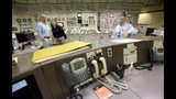 Control Room Supervisor Bob Sheridan, of Duxbury, Mass., left, and Senior Reactor Operator Kelly Connerton, of Middleborough, Mass., center, stand together in the Control Room Simulator moments before a simulated reactor shutdown, Tuesday, May 28, 2019, at a training facility several miles from the Pilgrim Nuclear Power Station, in Plymouth, Mass. The simulated shutdown was performed in front of members of the media ahead of the planned actual shutdown of the aging reactor on Friday, May 31. (AP Photo/Steven Senne)