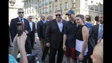 People take pictures of U.S. Secretary of State Mike Pompeo, center with sunglasses, during a sightseeing walk as part of Pompeo's visit in Bern, Switzerland, Saturday, June 1, 2019. (Peter Klaunzer/Keystone via AP)