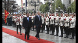 NATO Secretary General Jens Stoltenberg, accompanied by North Macedonia Prime Minister Zoran Zaev, left, inspects an honor guard during a welcome ceremony upon his arrival at the government building in Skopje, North Macedonia, Monday, June 3, 2019. NATO chief Jens Stoltenberg arrived for a two-day visit to North Macedonia before this tiny Balkan country officially becomes the alliance's 30th member by the end of the year. (AP Photo/Boris Grdanoski)