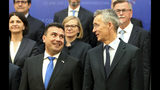 NATO Secretary General Jens Stoltenberg, right and North Macedonia Prime Minister Zoran Zaev, left, pose for photographers during a family photo, following the meeting with 29 ambassadors of top Alliance body (North Atlantic Council) in Skopje, North Macedonia, Monday, June 3, 2019. NATO Secretary-General Jens Stoltenberg has arrived for a two-day visit to North Macedonia before this tiny Balkan country officially becomes the alliance's 30th member by the end of the year. (AP Photo/Boris Grdanoski)