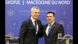 NATO Secretary General Jens Stoltenberg, left, shake hands with North Macedonia Prime Minister Zoran Zaev, right, during a news conference, following their meeting with 29 ambassadors of top Alliance body (North Atlantic Council) in Skopje, North Macedonia, Monday, June 3, 2019. NATO Secretary-General Jens Stoltenberg has arrived for a two-day visit to North Macedonia before this tiny Balkan country officially becomes the alliance's 30th member by the end of the year. (AP Photo/Boris Grdanoski)