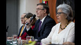 Mexican Foreign Affairs Secretary Marcelo Ebrard, center, speaks at a news conference at the Mexican Embassy in Washington, Monday, June 3, 2019, as a Mexican delegation arrives in Washington for talks following trade tariff threats from the Trump Administration. (AP Photo/Andrew Harnik)