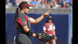 Oklahoma pitcher Giselle Juarez points in the fourth inning during an NCAA college softball game against Alabama in the Women's College World Series in Oklahoma City, Sunday, June 2, 2019. (Sarah Phipps/The Oklahoman via AP)
