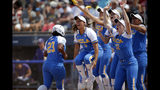 UCLA's celebrates Rachel Garcia three-run home run in the 10th inning against Washington during a Women's College World Series in Oklahoma City, Sunday, June 2, 2019. (Sarah Phipps/The Oklahoman via AP)