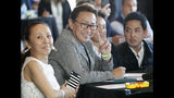 Master Ceremony owner Katsumi Yoshizawa, second from left, flashes a victory sign during a press conference with four trainers following a draw ceremony for the 2019 Belmont Stakes race, Tuesday, June 4, 2019, in New York. Trainer Koichi Tsunoda is third from left. (AP Photo/Kathy Willens)