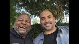 This photo provided by Mayer Brown LLP shows Kenneth Oliver, right, after his release from prison, posing for a selfie with his father Dr. Bernard Oliver on Tuesday, June 4, 2019. Kenneth Oliver, a California man, has been freed from prison after serving 23 years of his life sentence on a joyriding conviction. It included eight years in solitary confinement for possessing a book written by the co-founder of a notorious prison gang. (Bernard Oliver/Mayer Brown LLP via AP)