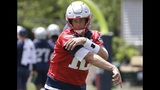 New England Patriots quarterback Tom Brady follows through after throwing the ball during an NFL football minicamp practice, Tuesday, June 4, 2019, in Foxborough, Mass. (AP Photo/Steven Senne)