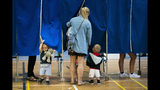 Children accompany their parents in the voting booth during voting at Sundby Idraetspark polling station in Copenhagen, Denmark, during the general elections on Wednesday June 5, 2019. (Martin Sylvest/Ritzau Scanpix via AP)