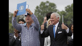 Carolina Panthers owner David Tepper, left, holds up the bill as South Carolina Gov. Henry McMaster, right, gives a thumbs up during a ceremonial bill signing in Rock Hill, S.C., Wednesday, June 5, 2019. The Panthers are planning on building a team facility with practice fields in the area. (AP Photo/Chuck Burton)