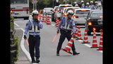 Police officers control traffic near the venue of G20 Finance Ministers' and Central Bank Governors' Meeting Friday, June 7, 2019, in Fukuoka, western Japan. (AP Photo/Eugene Hoshiko)
