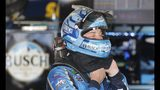 Kevin Harvick prepares to take his helmet off after a practice session for the NASCAR cup series race at Michigan International Speedway, Friday, June 7, 2019, in Brooklyn, Mich. (AP Photo/Carlos Osorio)