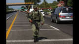 A Mexican Army soldier walks on the highway, near an immigration checkpoint in Tapachula, Chiapas state, Mexico, Saturday June 8, 2019. (AP Photo/Marco Ugarte)