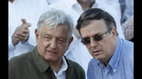 """Mexican President Andres Manuel Lopez Obrador, left, speaks with Mexican Foreign Relations Secretary Marcelo Ebrard during a rally in Tijuana, Mexico, Saturday, June 8, 2019. Mexican Foreign Relations Secretary Marcelo Ebrard has told a cheering crowd near the U.S. border that his country emerged from high-stakes talks over U.S. tariffs """"with its dignity intact."""" (AP Photo/Eduardo Verdugo)"""