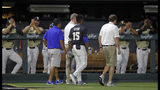 Duke's Kennie Taylor (15) leaves the field after being hit in the face by a pitch, as Vanderbilt payers applaud during the first inning of an NCAA college baseball tournament super regional game Saturday, June 8, 2019, in Nashville, Tenn. (AP Photo/Wade Payne)