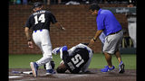 Duke's Kennie Taylor (15) rolls on the ground after being hit on the face by a pitch, while coach Chris Pollard and a trainer run to his aid during the first inning of the team's NCAA college baseball tournament super regional game against Vanderbilt on Saturday, June 8, 2019, in Nashville, Tenn. (AP Photo/Wade Payne)