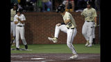 Vanderbilt's Pat DeMarco (18) stomps on home plate to score in the eighth inning of the team's NCAA college baseball tournament super regional game against Duke Saturday, June 8, 2019, in Nashville, Tenn. (AP Photo/Wade Payne)