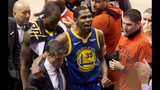 Golden State Warriors forward Kevin Durant (35) reacts as he leaves the court after sustaining an injury during first-half basketball action against the Toronto Raptors in Game 5 of the NBA Finals in Toronto, Monday, June 10, 2019. (Chris Young/The Canadian Press via AP)