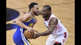 Toronto Raptors forward Kawhi Leonard (2) defends against Golden State Warriors guard Stephen Curry (30) during first-half basketball action in Game 5 of the NBA Finals in Toronto, Monday, June 10, 2019. (Frank Gunn/The Canadian Press via AP)