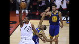 Toronto Raptors forward Kawhi Leonard (2) drives past Golden State Warriors forward Andre Iguodala during first-half basketball action in Game 5 of the NBA Finals in Toronto, Monday, June 10, 2019. (Nathan Denette/The Canadian Press via AP)