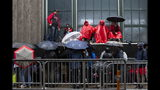 Fans wait outside Scotiabank Arena in Toronto to gain access to the fan area known as 'Jurassic Park' ahead of basketball's Game 5 of the NBA Finals between the Toronto Raptors and Golden State Warriors, Monday, June 10, 2019. (Chris Young/The Canadian Press via AP)