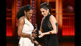 """Audra McDonald presents the award for best performance by an actress in a leading role in a musical to Stephanie J. Block for """"The Cher Show"""" at the 73rd annual Tony Awards at Radio City Music Hall on Sunday, June 9, 2019, in New York. (Photo by Charles Sykes/Invision/AP)"""