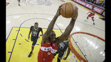 Toronto Raptors center Serge Ibaka (9) dunks against the Golden State Warriors during the second half of Game 4 of basketball's NBA Finals in Oakland, Calif., Friday, June 7, 2019. (AP Photo/Tony Avelar, Pool)