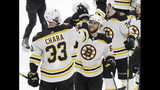 Boston Bruins defenseman Zdeno Chara (33), of Slovakia, celebrates with right wing David Pastrnak (88), of the Czech Republic, after the Bruins beat the St. Louis Blues in Game 6 of the NHL hockey Stanley Cup Final Sunday, June 9, 2019, in St. Louis. Both players scored goals as the Bruins won 5-1 to even the series 3-3. (AP Photo/Jeff Roberson)