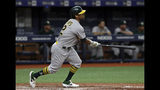 Oakland Athletics' Khris Davis watches his home run off Tampa Bay Rays relief pitcher Emilio Pagan during the sixth inning of a baseball game Tuesday, June 11, 2019, in St. Petersburg, Fla. (AP Photo/Chris O'Meara)