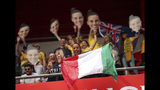 Fans cheer for their teams prior the start of the Women's World Cup Group C soccer match between Australia and Italy at the Stade du Hainaut in Valenciennes, Sunday, June 9, 2019. (AP Photo/Francisco Seco)