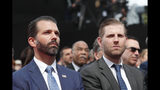 Donald Trump Jr., left, and Eric Trump attend a ceremony to mark the 75th anniversary of D-Day at the Normandy American Cemetery in Colleville-sur-Mer, Normandy, France, Thursday, June 6, 2019. World leaders are gathered Thursday in France to mark the 75th anniversary of the D-Day landings. Man at left is unidentified. (Ian Langsdon/POOL via AP)