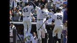 New York Yankees' Luke Voit, left, celebrates with Gary Sanchez, center, after hitting a three-run home run against the New York Mets during the fourth inning in the first baseball game of a doubleheader, Tuesday, June 11, 2019, in New York. (AP Photo/Frank Franklin II)