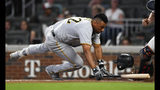 Pittsburgh Pirates Elias Diaz dodges a wild pitch by Atlanta Braves' Anthony Swarzak during the eighth inning of a baseball game Tuesday June 11, 2019, in Atlanta. (AP Photo/John Amis)