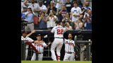Atlanta Braves' Nick Markakis (22) is congratulated as he enters the dugout after hitting a home run to center field during the second inning of a baseball game against the Pittsburgh Pirates, Tuesday June 11, 2019, in Atlanta. (AP Photo/John Amis)