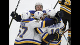 St. Louis Blues' Ryan O'Reilly, center, celebrates his goal with teammates Alex Pietrangelo, left, Sammy Blais, rear, and Jay Bouwmeester, right, during the first period in Game 7 of the NHL hockey Stanley Cup Final against the Boston Bruins, Wednesday, June 12, 2019, in Boston. (AP Photo/Charles Krupa)