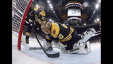 Boston Bruins' Zdeno Chara, left, of Slovakia, reaches behind goaltender Tuukka Rask, of Finland, to keep the puck from crossing the goal line during the second period in Game 7 of the NHL hockey Stanley Cup Final against the St. Louis Blues, Wednesday, June 12, 2019, in Boston. (Bruce Bennett/Pool via AP)