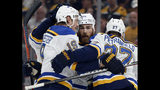 St. Louis Blues' Ryan O'Reilly, center, celebrates his goal with teammates Jay Bouwmeester, left, and Alex Pietrangelo, right. during the first period in Game 7 of the NHL hockey Stanley Cup Final against the Boston Bruins, Wednesday, June 12, 2019, in Boston. (AP Photo/Michael Dwyer)