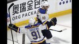 St. Louis Blues' Brayden Schenn (10) celebrates his goal against the Boston Bruins with Vladimir Tarasenko (91), of Russia, during the third period in Game 7 of the NHL hockey Stanley Cup Final, Wednesday, June 12, 2019, in Boston. (AP Photo/Charles Krupa)