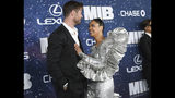 """Actors Chris Hemsworth, left, and Tessa Thompson attend the world premiere of """"Men in Black: International,"""" at the AMC Loews Lincoln Square, Tuesday, June 11, 2019, in New York. (Photo by Evan Agostini/Invision/AP)"""