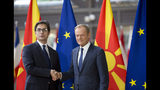 European Council President Donald Tusk, right, shakes hands with North Macedonia's President Stevo Pendarovski prior to a meeting at the Europa building in Brussels, Wednesday, June 12, 2019. (AP Photo/Virginia Mayo)