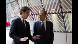 European Council President Donald Tusk, right, speaks with North Macedonia's President Stevo Pendarovski prior to a meeting at the Europa building in Brussels, Wednesday, June 12, 2019. (AP Photo/Virginia Mayo)
