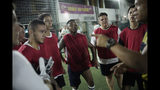 "In this May 27, 2019 photo, Bigtboys transgender men's soccer player Bruno dos Santos, center, and his teammates listen to their coach during a game against the Alligaytors, a gay men's team in Rio de Janeiro, Brazil. ""Despite dozens of bills, only homophobic and transphobic discrimination remains without any kind of (legal sanction),"" Supreme Court Justice Alexandre de Moraes said during a session in February. (AP Photo/Silvia Izquierdo)"