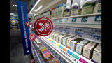 FILE- In this May 30, 2019, file photo, signs advertise new products available inside a CVS store with the new HealthHUB in Spring, Texas. On Wednesday, June 12, the Labor Department reports on U.S. consumer prices for May. (AP Photo/David J. Phillip, File)