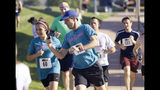 Democratic presidential candidate Beto O'Rourke, center, runs the Capital City Pride Fest Fun Run 5K, Saturday, June 8, 2019, in Des Moines, Iowa. (AP Photo/Charlie Neibergall)